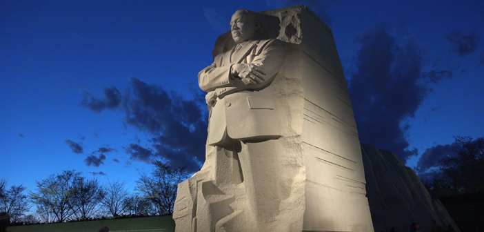 WASHINGTON, DC - MARCH 2016: Under awesome dusk sky, Martin Luther King Memorial, tilt up. Inscription Wall and tourists in background. MLK Memorial opened August, 2011 and can be visited at night.  bakdc / Shutterstock, Inc.