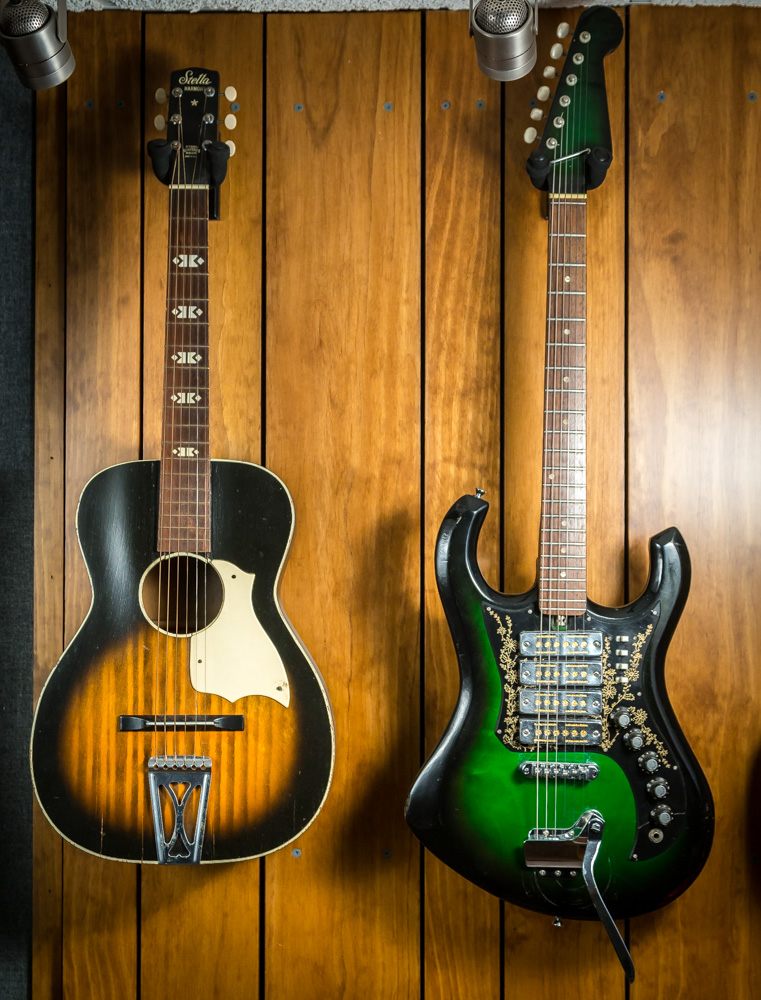 One favored guitar (R) he bought and sold decades ago, then tracked down and bought back.