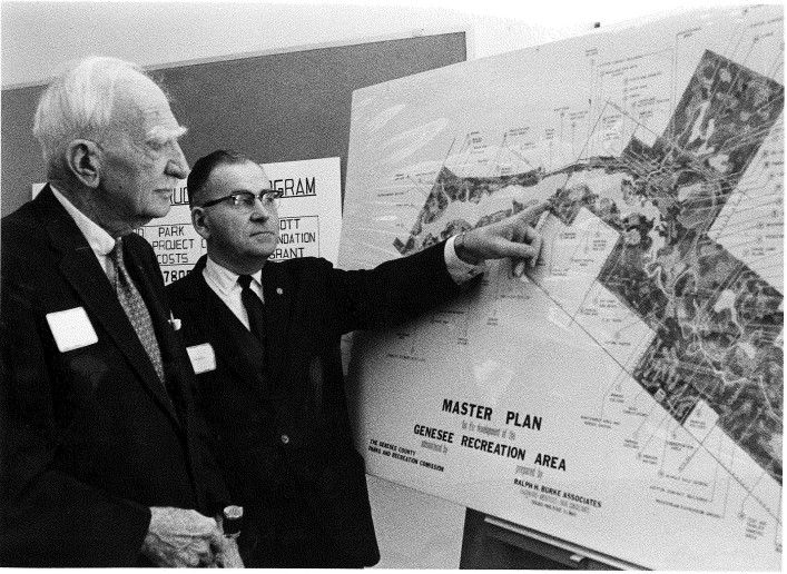 C.S. Mott and Parks Commission Board Chairman, Carl Ammerman, review the first Master Plan of the Genesee Recreation Area in 1968.