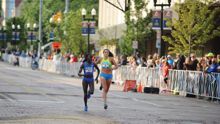 Gabi Anzalone secures 7th place among women by surging past Kenya's Lineth Chepkuri just before the finish line of the 2017 Crim 10-mile race.